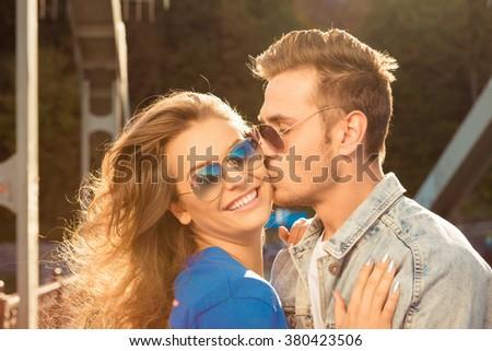 Romantic couple in love on the bridge with glasses - stock photo