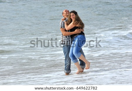 Romantic couple , in love, walking and dating on the beach