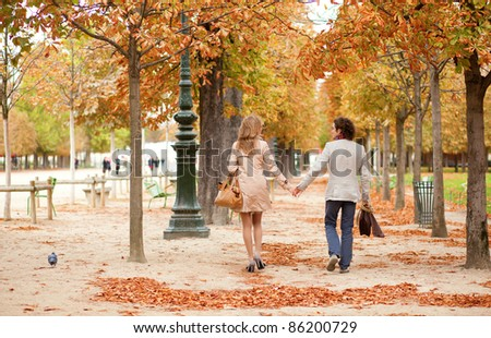 Romantic couple in Paris, having a date at fall - stock photo