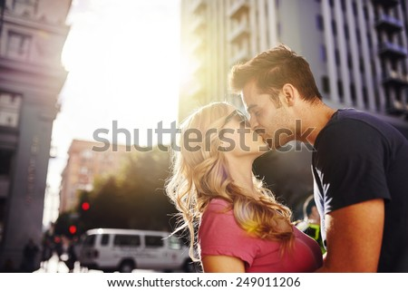 romantic couple kissing in downtown los angeles - stock photo