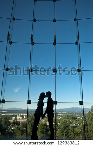 Romantic couple kissing in silhouette