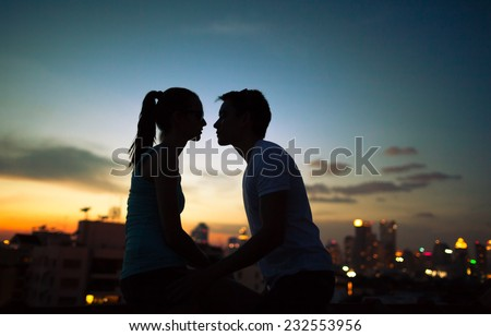 Romantic couple kissing in the city - stock photo