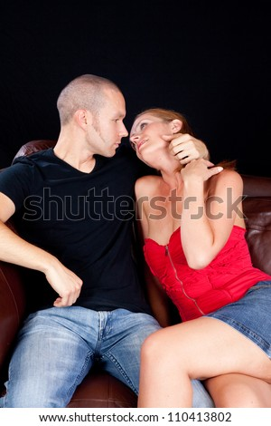 Romantic couple making out on the couch,