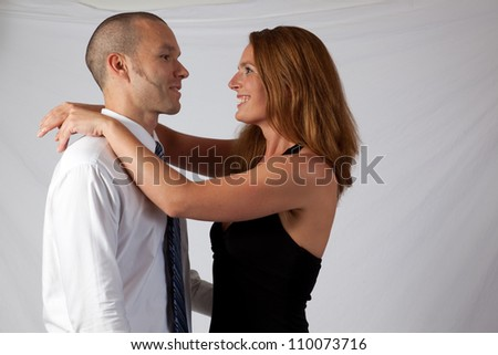Romantic couple, man and woman, in a loving embrace - stock photo