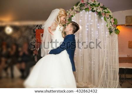 Romantic couple of newlyweds first elegant dance at wedding reception hall - stock photo
