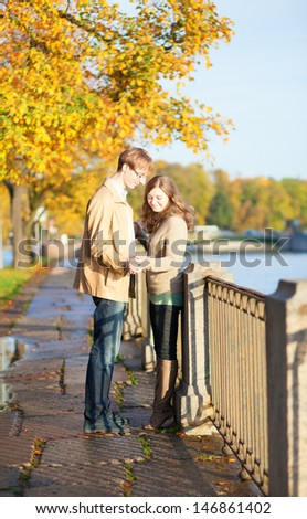 Romantic couple on a beautiful autumn day - stock photo