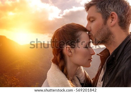 romantic couple on mountains travel
