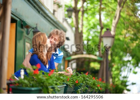 Romantic couple on the balcony of their house or hotel - stock photo