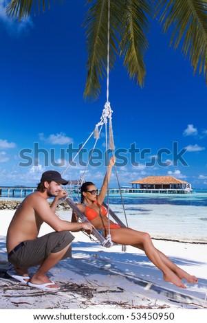 Romantic couple resting at Maldives seaside - stock photo