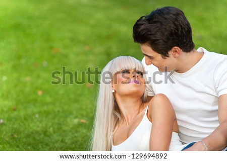 Romantic couple sharing quality time in park. - stock photo