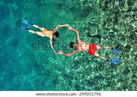 Romantic couple snorkeling in Phuket, Thailand - stock photo