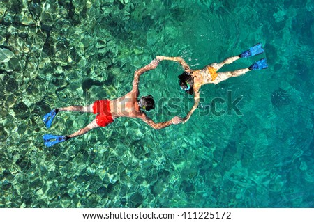 Romantic couple snorkeling in Thailand - stock photo