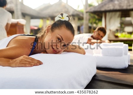 Romantic Couple Spa. Closeup Of Beautiful Healthy Happy Smiling Woman, Handsome Man Relaxing At Day Spa Resort. People Enjoying Body Relaxation Massage Outdoors In Summer. Relax Treatment Concept - stock photo