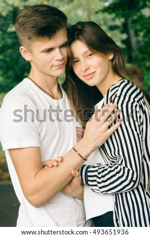 Romantic couple together in a park in autumn