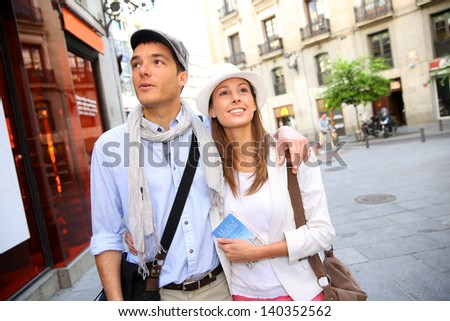 Romantic couple walking in the streets of Madrid, Spain - stock photo