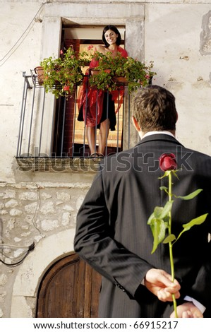Romantic couple with roses - stock photo