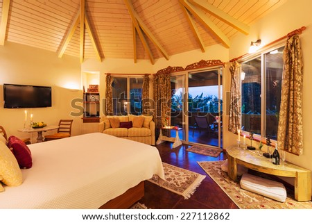 Romantic Cozy Bedroom with Hardwood Floors at Sunset. Home Interior Design - stock photo