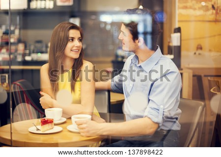 Romantic date in cafe - stock photo