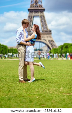 Romantic dating couple in Paris near the Eiffel tower - stock photo