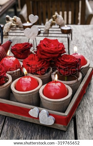 Romantic decoration with roses and scented candles in wooden box. Decoration for Valentines day. Easy and cheap home decor. - stock photo