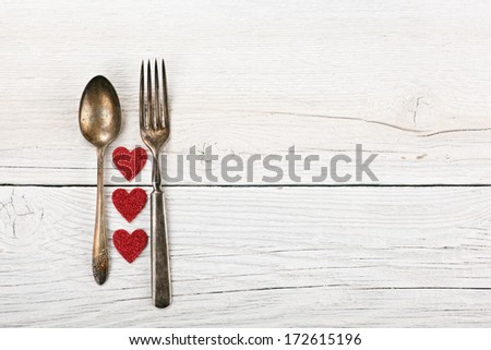 Romantic Dinner concept on rustic whitewash table - stock photo