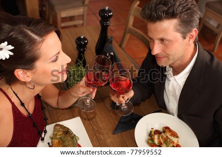 romantic dinner for two - couple in a restaurant - stock photo