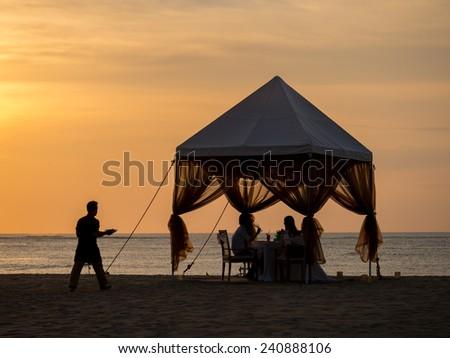 Romantic dinner on the beach in Bali - stock photo