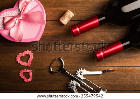 Romantic dinner with a gift and wine - stock photo
