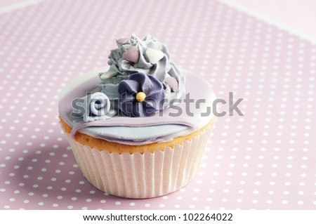 romantic flower cupcake with hearts and buttercream - stock photo