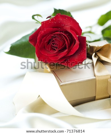 Romantic Gift and Rose - stock photo