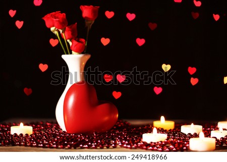 Romantic gift with candles on lights background, love concept - stock photo