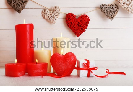 Romantic gift with candles on wooden background. Love concept - stock photo