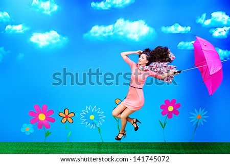 Romantic girl is running through the fabulous field of flowers. - stock photo