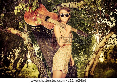 Romantic girl travelling with her guitar. Summer. Hippie style.  - stock photo