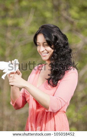 Romantic girl with a white dove in his hand /Girls in paradise - stock photo