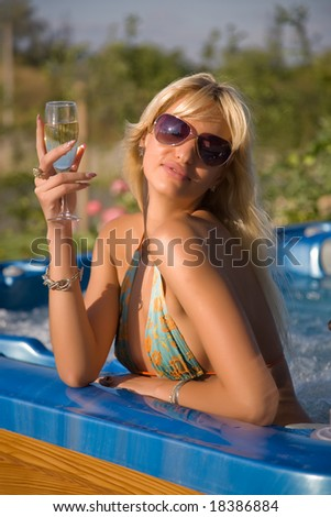Romantic girl with champagne glass - stock photo