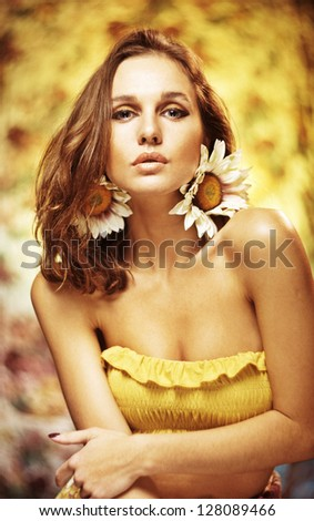 Romantic girl with flower meadow - stock photo