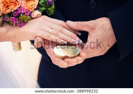 Romantic hands holding heart shaped lock. - stock photo