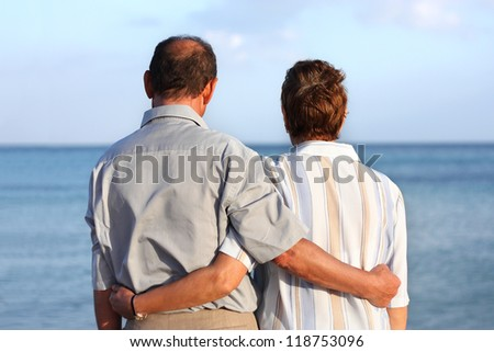 Romantic happy senior couple on a tropical beach - stock photo