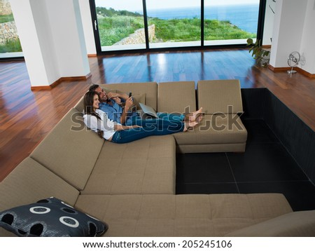 romantic happy young couple relax at modern home indoors - stock photo
