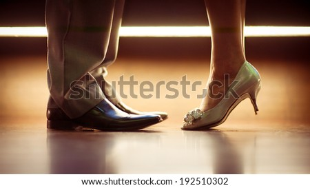 Romantic Legs and shoes of a man and woman - stock photo
