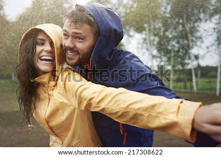 Romantic love in the pouring rain
