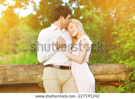 Romantic lovely young couple in love outdoors, warm tender feelings - stock photo