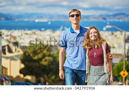 Romantic loving couple having a date in San Francisco, California, USA - stock photo