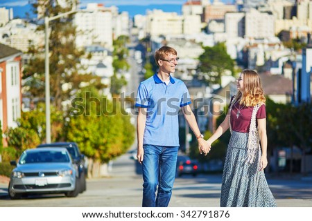 Romantic loving couple walking in San Francisco, California, USA - stock photo