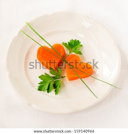 Romantic Low Calorie Dinner, Carrot Hearts  - stock photo