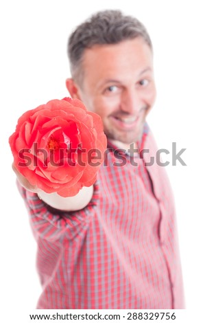 Romantic male offering flower. Lover concept isolated on white background - stock photo