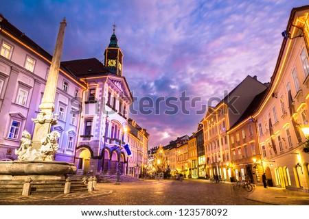 Romantic medieval Ljubljana's city center, the capital of Slovenia, Europe. City's square, City hall and Roba's fountain shot at dusk. - stock photo