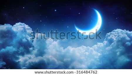 Romantic Moon In Starry Night Over Clouds
