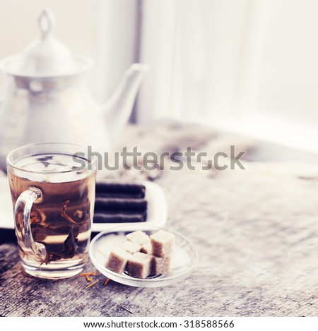 romantic morning background with cup of tea  on wooden table/ breakfast toned vintage background